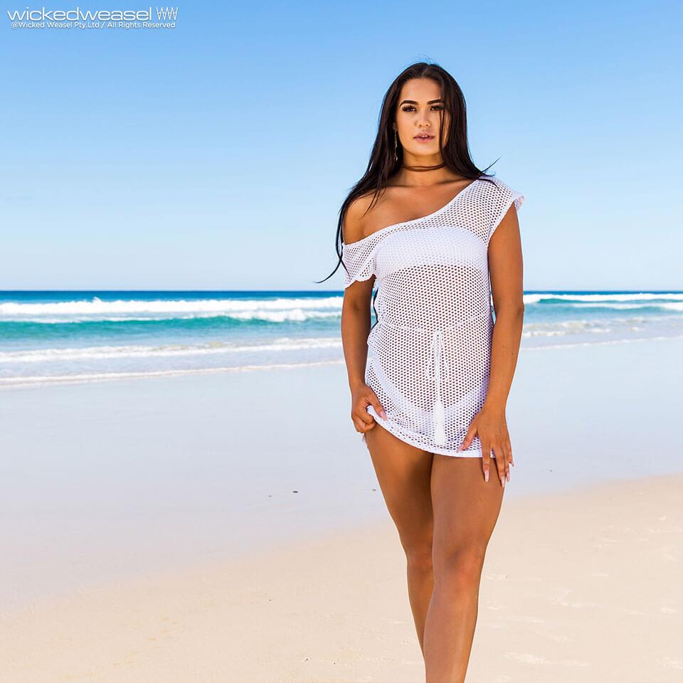 girl on beach in sheer mesh dress