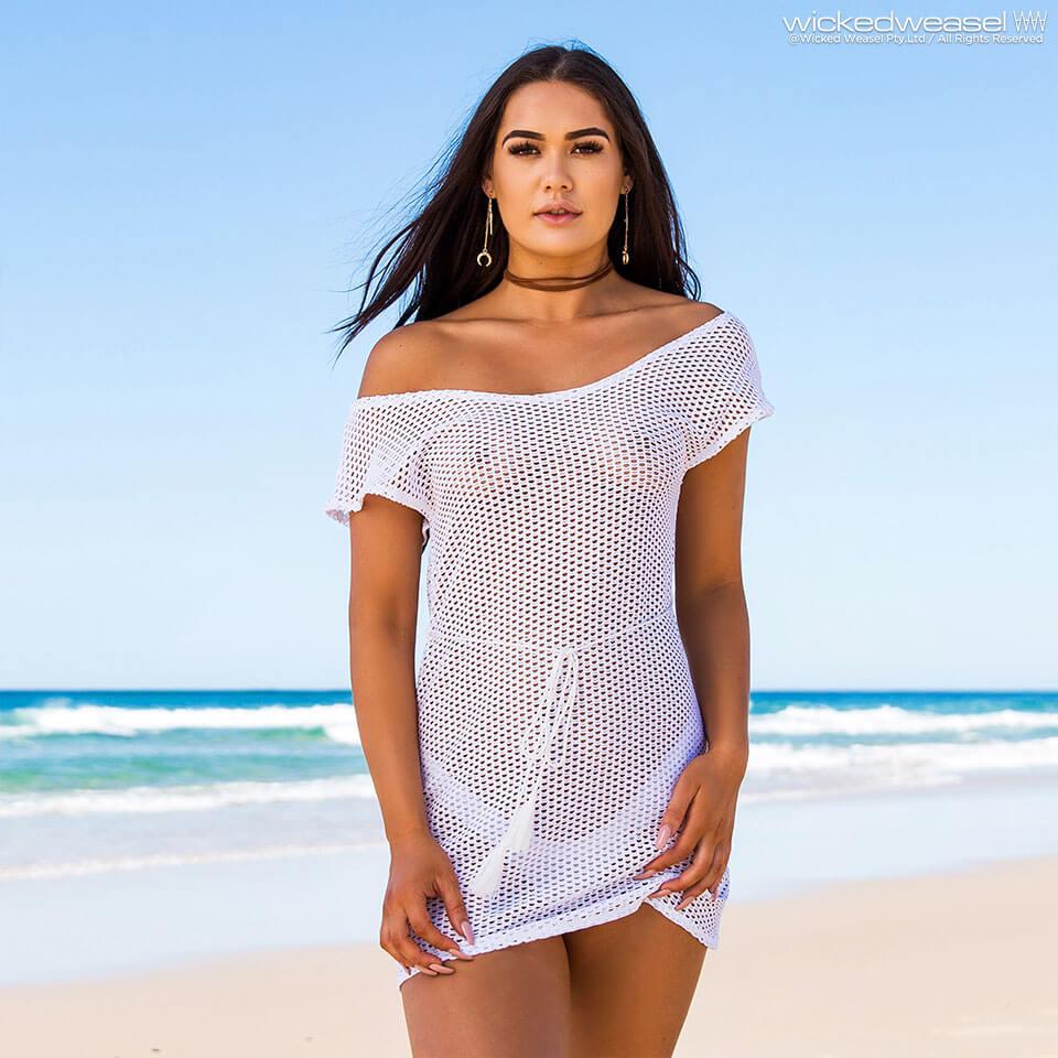 girl on beach wearing white sheer mesh dress