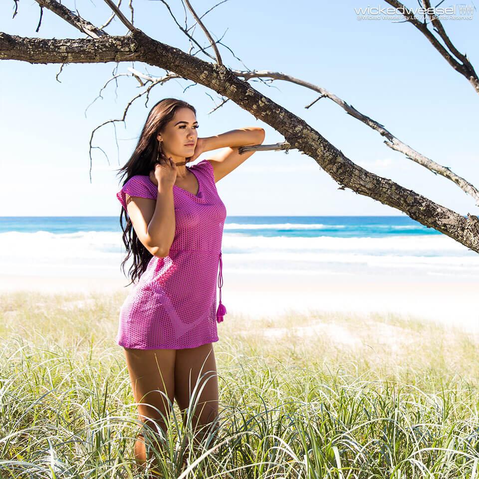 girl on beach wearing sheer mesh dress